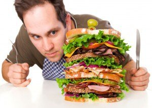 fitness-voeding-man-die-sandwich-eet